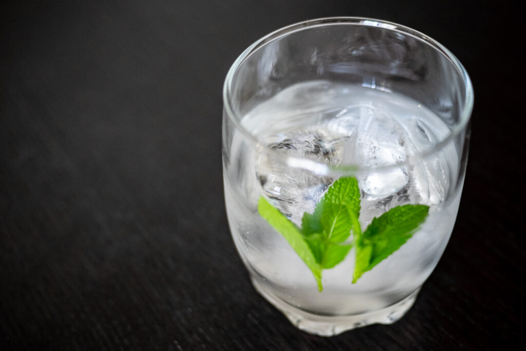 Shochu in a glass with ice and water and a couple of sprigs of mint.