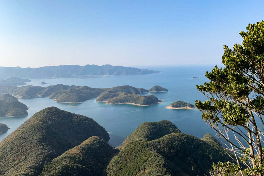 The rolling vegetated hills of Tsushima Island and the blue waters of the Tsushima Strait from Mt Joyama.