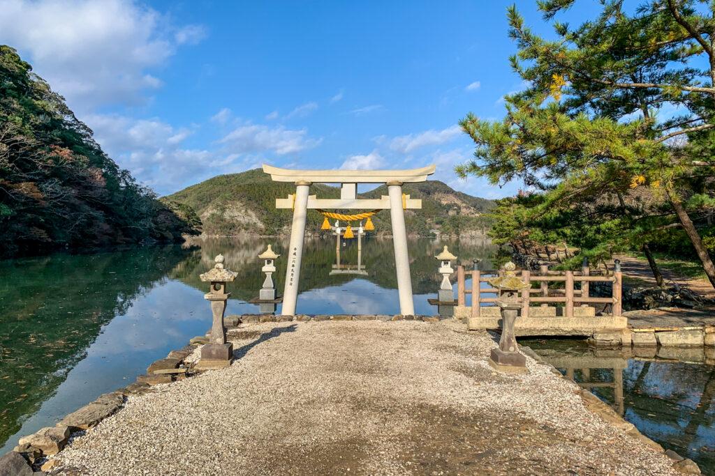The Torii gate of Watatsumi Shrine on Tsushima Island overlooking the water.