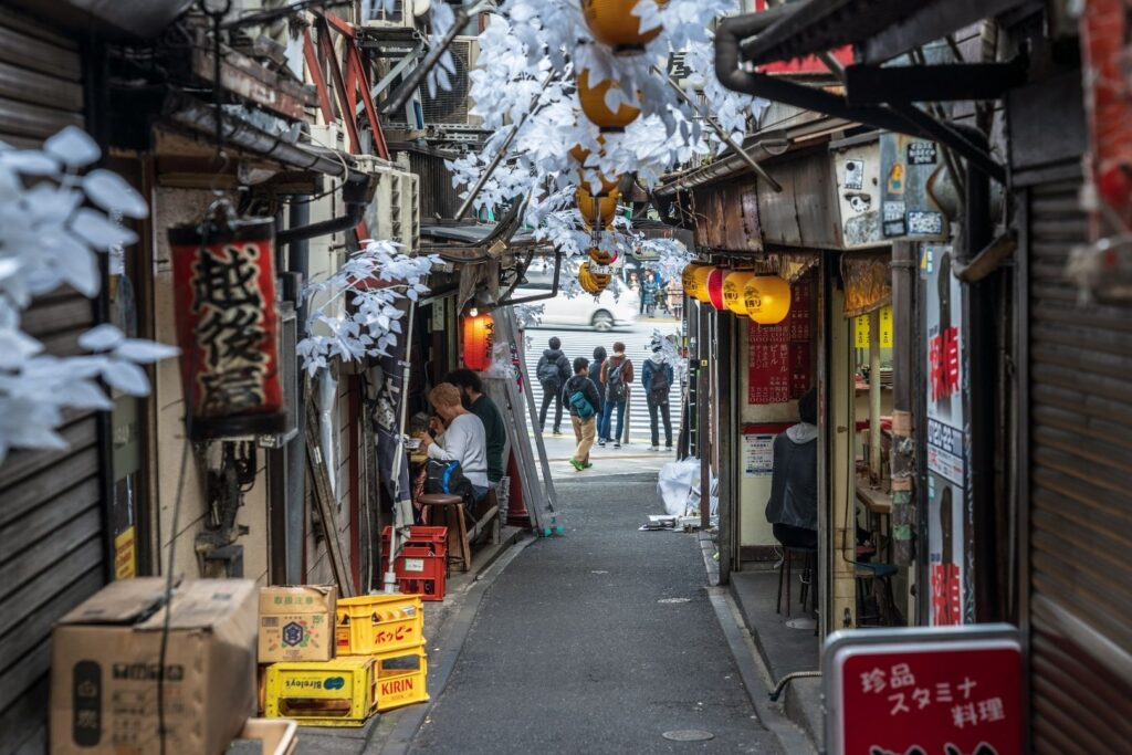A picture of an alleyway in Tokyo (Omoide Yokocho), where a couple of the small drinking and eating spots have opened up for the evening. At places like this the chu hai is a staple drink.