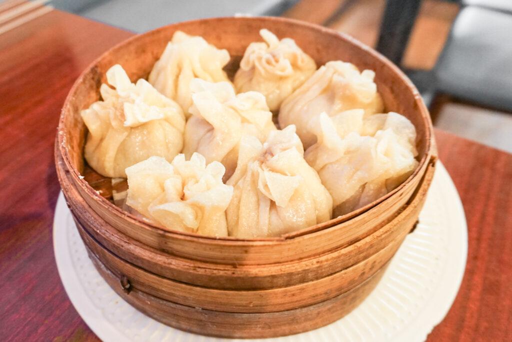 A serving of eight halal shumai dumplings in a bamboo basket at Aliya halal restaurant in Tokyo.