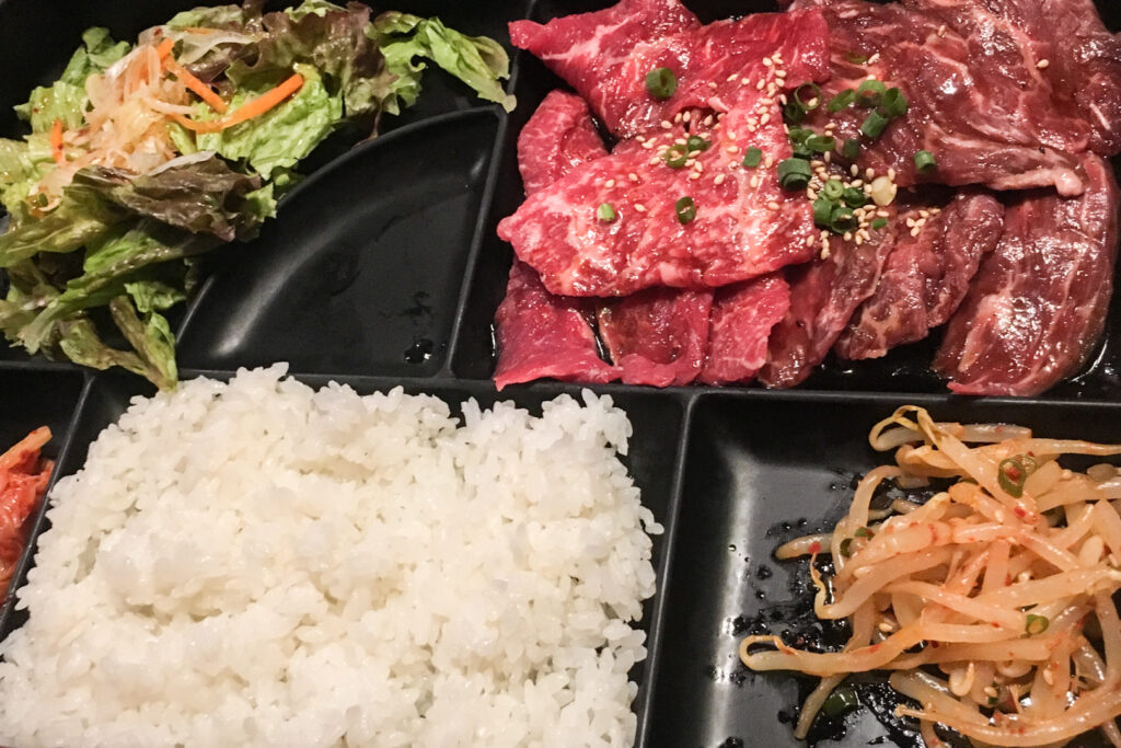 Halal restaurants in Tokyo - a halal yakiniku lunch set menu from Yakiniku Panga. It contains raw beef (to be cooked yourself on the grill), rice, Korean namul and kimchi, and salad.