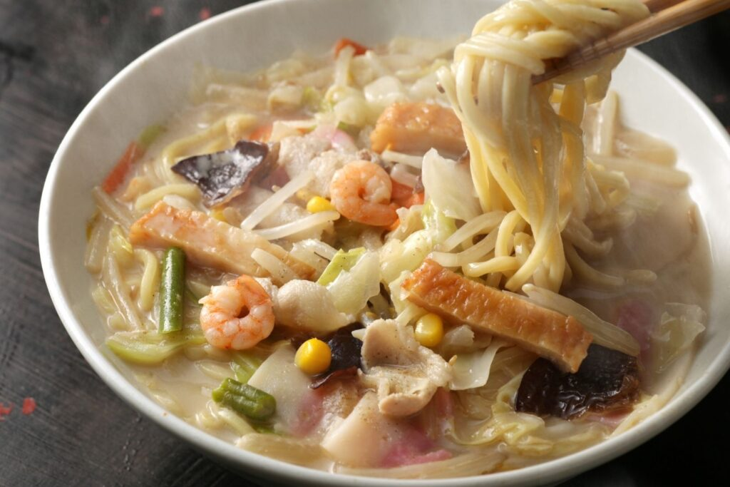 Nagasaki Food Guide: A plate of Nagasaki Champon, a noodle dish made up of pork, seafood, and veggies with a soup base of chicken and pork bones, and champon noodles.